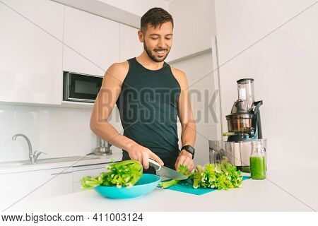 Healthy Fitness Sportsman Making Fresh Detox Homemade Celery Juice In Juicer Machine At Home. Health