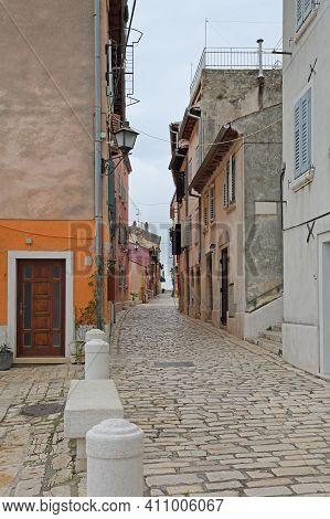 Mediterranean Cobblestone Street In Charming Town Rovinj Istria Croatia