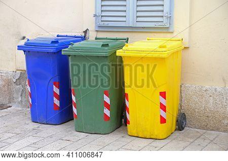 Three Recycling And Sorting Plastic Trash Wheelie Bins