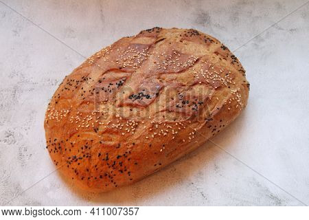 A Large Loaf Of Bread, Bread Sprinkled With Black And White Sesame Seeds, Crispy Bread, White Flour