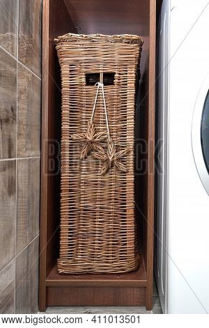 Wicker Laundry Basket Stands On A Wooden Shelf In A Laundry Room. Scandinavian Interior Of Laundry R