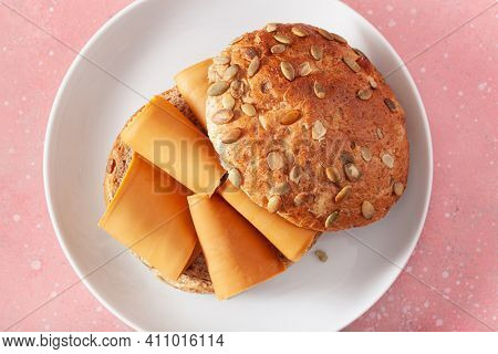 fresh bun with Norwegian brunost traditional brown cheese
