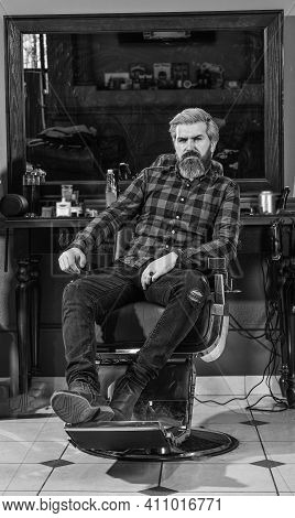 Beard And Mustaches. Professional Hairstylist In Barbershop Interior. Portrait Of Stylish Man Beard.