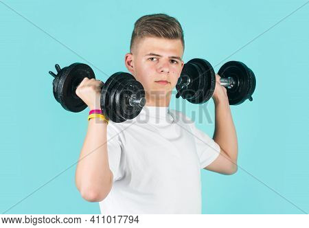 He Is Strong. Concept Of Fitness. Child Workout With Dumbbell. Power And Strength. Weightlifting.