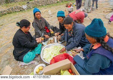 Mulbekh, Ladakh, India - 2nd September 2014 : Ladakhi Tribal Women In Traditional Dresses Are Cuttin