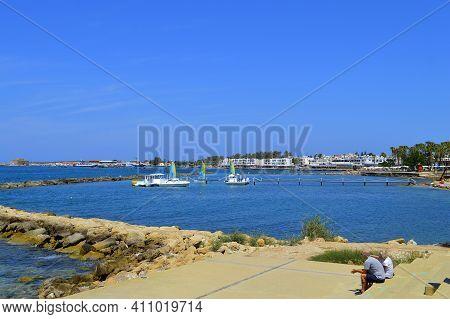 Paphos, Cyprus, Greece - June 5, 2018 : Tourists Resting In Paphos Harbour A Popular Tourist Resort