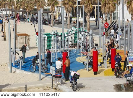 Israel, Tel Aviv, February, 2018 -  Fitness Equipment And People Involved In Sports At Waterfront Pa