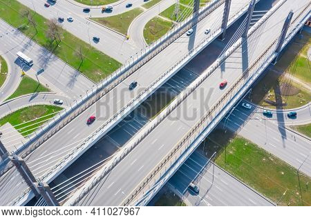 Crossroads Of Two Major Highways With Cable-stayed Bridge And Road Junction In The City, Aerial View