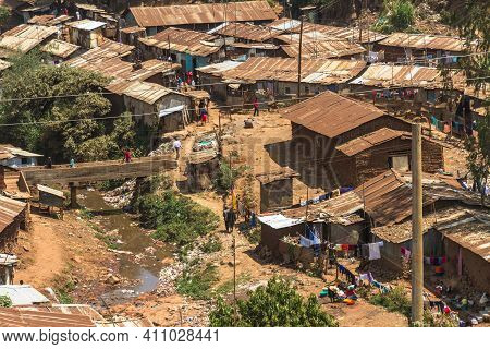 People Go About Their Daily Life Routines In Part Of The Kibera Slum In Nairobi, Kenya