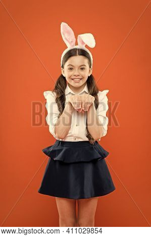 Small Girl Wearing Bunny Ears On Easter Day. Happy Child In Costume. Easter Bunny Rabbit With Ears.