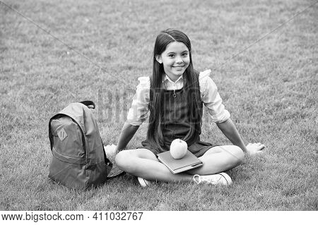 Education Towards Freedom. Happy Child Relax On Green Grass. Happy Childhood. Back To School. Early