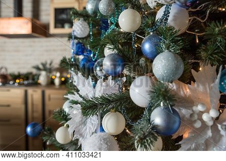 Christmas Tree With Blue And White Toys In The Interior.christmas Card With White And Blue Decor.hol