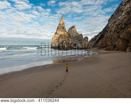 Aerial Panorama Of Young Male Tourist In Yellow Jacket At Praia Da Ursa Atlantic Coast Rocky Cliff S