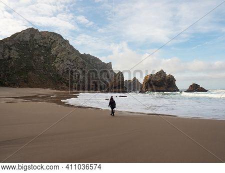 Panorama View Of Young Female Tourist With Camera Walking Along Praia Da Ursa Atlantic Coast Shore R