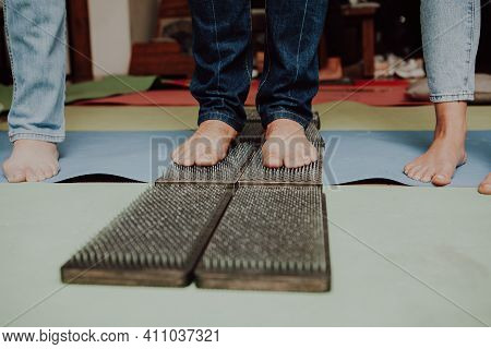 Group Practice Of Standing On Nails.\rsadhu Wooden Board With Nails For Sadhu Practice.