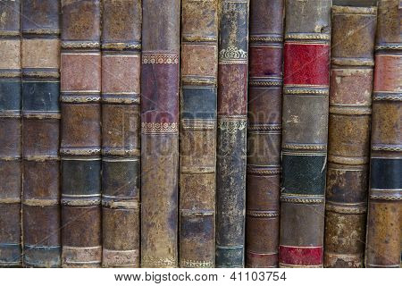 A pile of old weathered books