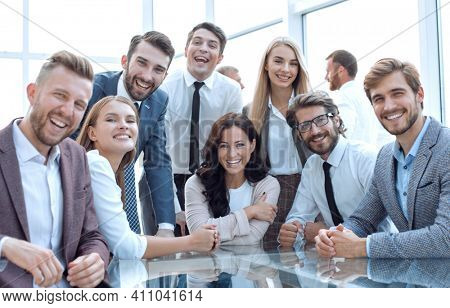 professional team of young business people sitting at the table.