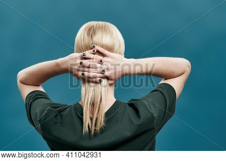 Rear View Of Groomed Young Caucasian Man With Long Blond Hair And Manicured Hands On Head While Posi