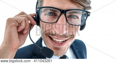 Smiling businessman talking on headset against a white backgroun