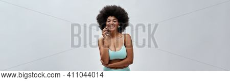 Excited Voluptuous Young Woman With Afro Hair Style Wearing Blue Underwear Laughing At Camera, Posin