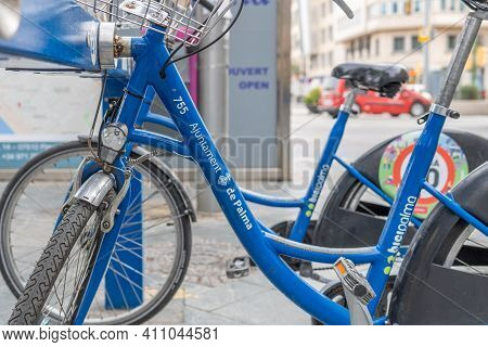 Palma De Mallorca, Spain; March 04 2021: Close-up Of A Parked Blue Bicycle, Bicipalma. Public Bicycl
