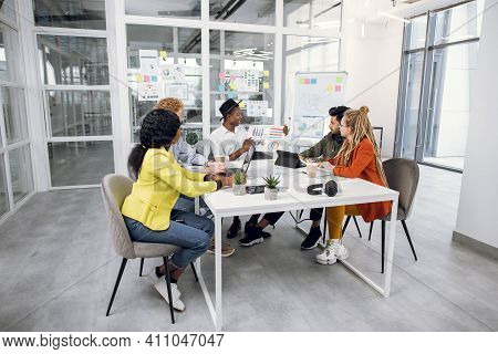 Five Multicultural It Specialist Having Working Meeting At Bright Office. Creative Business People I