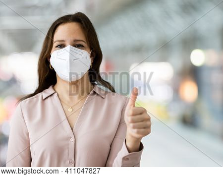 Plane Passenger In Airport Wearing Facemask Or Face Mask