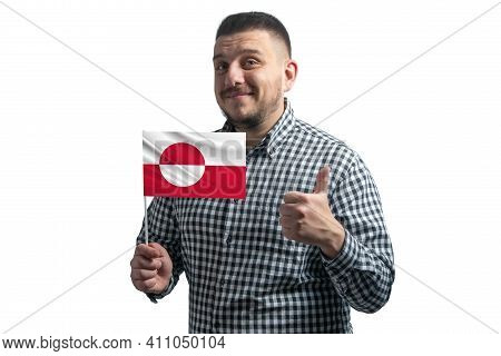White Guy Holding A Flag Of Greenland And Shows The Class By Hand Isolated On A White Background. Li