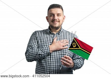 White Guy Holding A Flag Of Vanuatu And Holds His Hand On His Heart Isolated On A White Background W