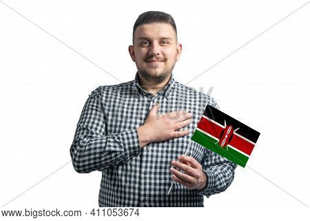White Guy Holding A Flag Of Kenya And Holds His Hand On His Heart Isolated On A White Background Wit