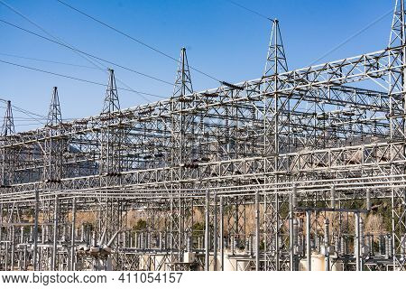 Electrical Generation Station With Mountains In The Background