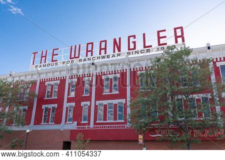 Cheyenne, Wyoming - April 27, 2018: Sign On Top Of The Wrangler In Historic Downtown Cheyenne Wyomin