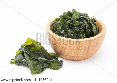 Fresh Seaweed Wakame In Wooden Bowl Isolated On White Background. Japanese Food