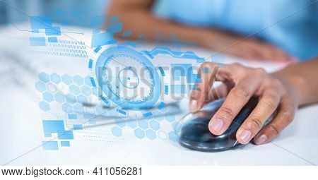 Scope with digital icons over woman using computer. global technology, business and finance concept digitally generated image.