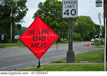 One Lane Road Ahead Construction Sign On The Side Of A Five Lane Road