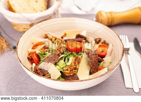 Juicy Beef Sirloin Steak Salad With Roasted Tomatoes, Parmesan, Nuts And Greens. Healthy Food Served