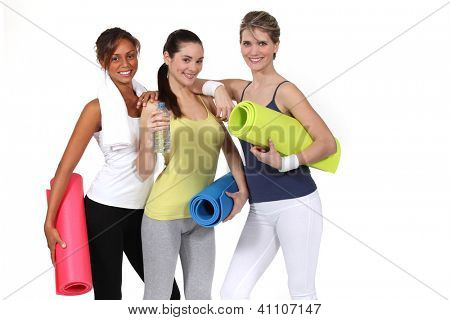Woman with gym mats