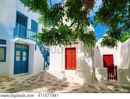 Romantic Traditional Narrow Cobbled Streets, Beautiful Small Squares Of Greek Island Towns. Whitewas