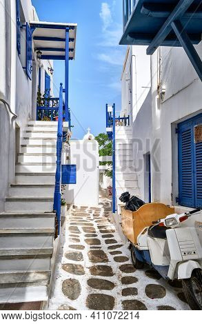 Beautiful Traditional Narrow Streets, Cobbled Alleyways Of Greek Island Town. Whitewashed Houses, Bl