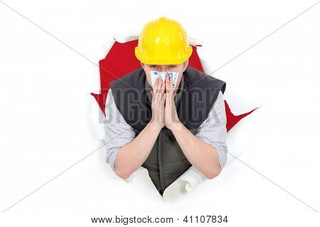 Builder smelling bank note