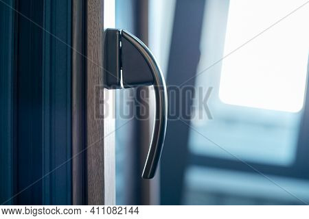 Close-up. Metal Handle On The Window Frame.