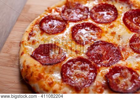 Delicious Hot Homemade Pepperoni Pizza. Italian Pepperoni Pizza With Salami, Close Up