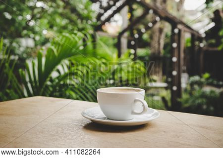 Cup Of Coffee On Brown Wooden Table At Coffee Shop. Hot Cappuccino The Best Start To Any Morning At