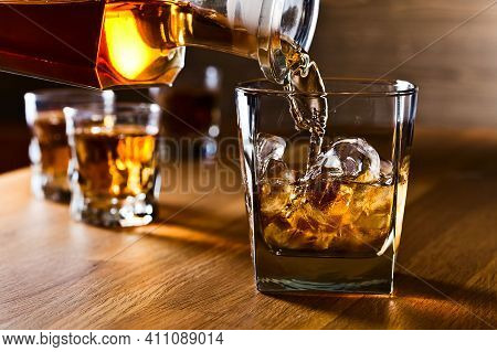 Alcohol Drink, Glass With An Alcoholic Drink. Bottles Of Alcohol. Alcohol Addiction. Harm To The Bra
