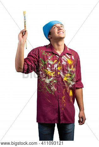 Smiling Young Painter Artist Holding Paintbrush. Portrait Of Happy Painter Looking Upwards Isolated