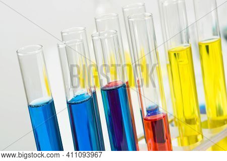 Science Laboratory Research And Development. Close Up Test Tubes With Colorful Substance On White Ba