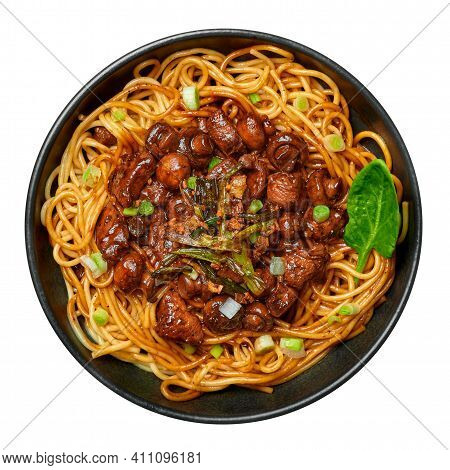 Bakmi Or Mie Ayam In Black Bowl Isolated On White. Indonesian Cuisine Noodles Meat Dish. Traditional