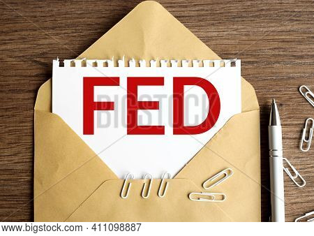 Federal Reserve. Fed Business And Finance Concept. Text On White Paper. On Paper In An Envelope On A