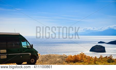 Tourism Vacation And Travel. Camper Van Motorhome On Beach Sea Shore In Summer Time, Greece