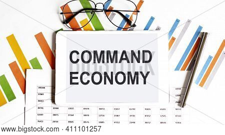 The Tablet With Text Command Economy On The Business Charts And Pen